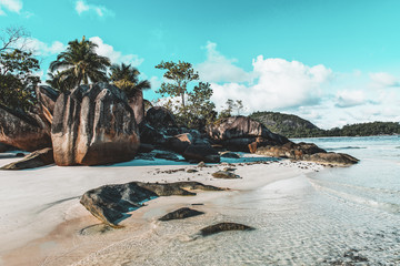 Idyllic tropical island beach with rock formation