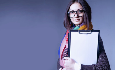 Time to work. Portrait of young attractive female recruiter holding paper and waiting for job interview. (employment, salary, security, hope, business concept)