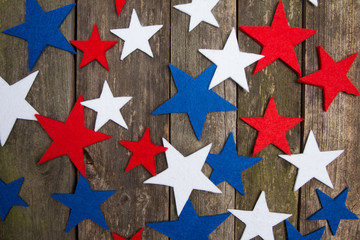Blue, white and red stars. Wooden background. American Presidents day.
