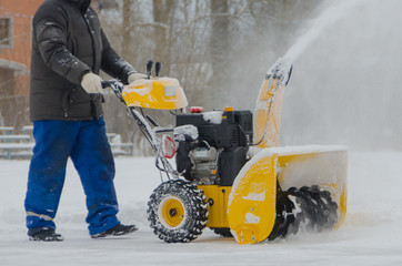 removes snow worker snowthrower