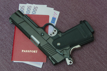 euros money invested in the passport next to the gun