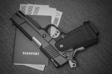 next to the pistol euros money invested in the passport