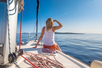 Woman enjoying a yacht trip at the sea on the Greece coastline