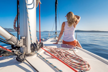Woman enjoying a day on a yacht trip at the sea on the Greece coastline