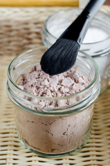 Mineral homemade powder foundation or dry shampoo in a grass jar. DIY cosmetics. Close up, copy space.