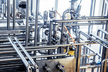 Stainless steel pipes in the factory. Construction on food production, Abstract industry background.