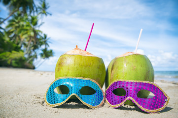 Poster Carnaval Colorful sequined carnival masks and fresh green coconut drinks on a palm fringed beach in Brazil