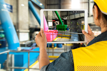 Industrial 4.0 , Augmented reality concept. Hand holding tablet with AR service , maintenance application and calling technician for check destroy part of smart machine in smart factory background. Wall mural