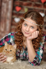 Beautiful teen girl with a cat in hands