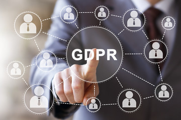 Businessman presses button GDPR Data Protection Regulation on virtual digital electronic user interface.