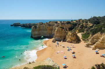 View of limestone cliffs and the Rabbit Beach (Praia da Coelha) in Albufeira, District Faro, Algarve, Southern Portugal