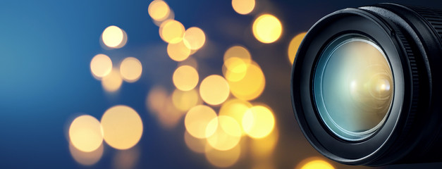 Camera lens with bokeh lights background