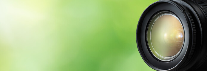 Camera lens close up and green background