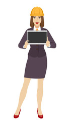 Businesswoman construction helmet showing blank digital tablet PC