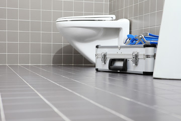 plumber tools and equipment in a bathroom, plumbing repair service, assemble and install concept, copy space template