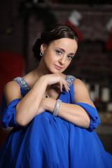 elegant woman in retro style in a blue dress