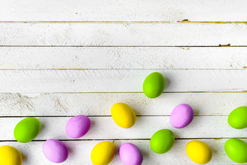 Spring easter eggs background, seasonal colorful painted eggs on white wooden boards