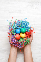 Photo of multi-colored Easter eggs and hands
