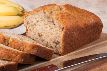 Closeup of a loaf of sliced banana nut bread