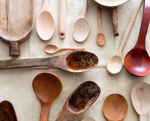 empty design and ethnic carved wooden spoons mixed on linen