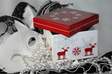 Winter red and white present box giftbox and lacy black and white background