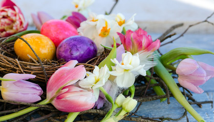Happy Easter: nest with Easter eggs, feathers, tulips and daffodils:) Wall mural