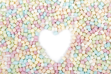 White area with the shape of heart in colorful marshmallow background