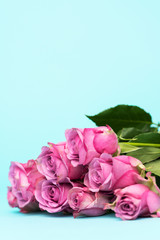 Happy Mother's Day, Women's Day, Valentine's Day or Birthday Background. Greeting card with beautiful fresh pink roses and copy space.