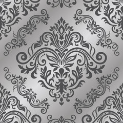Seamless background of silver color in the style of baroque. Vector seamless border in Victorian style. Damask wallpaper
