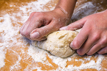 female hands and dough