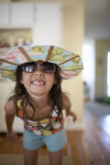 Girl with sunglasses grinning
