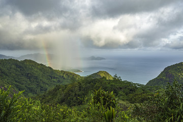 rainbow and rain over the jungle and mountains of mahé, seychelles 13