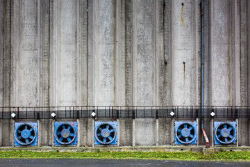Conrete wall of a cereal silo tower with vents