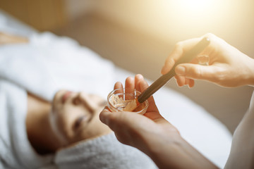 Young woman having mask procedure in spa centre