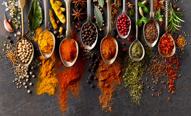 Spices on black background Wall mural