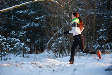 Image of young athlete running through winter forest