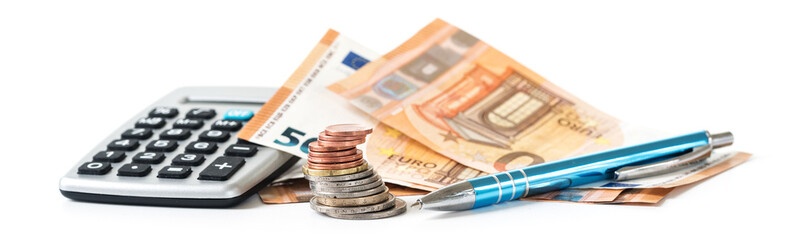 financial planning with coins and euro banknotes, a calculator and a pen isolated on a white background, panoramic banner format