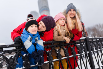 Picture of happy parents with daughter and son on winter walk