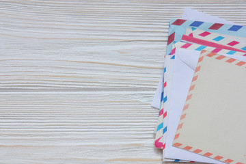 old envelopes and cards on wooden back