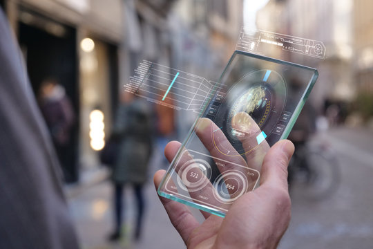 A man in the city, use the transparent phone with the latest technology for video calls with holography family on vacation. Concept: technology, future and futuristic technology, family