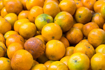 Healthy fruits, orange fruits background many orange fruits - orange fruit background