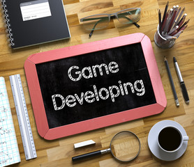 Game Developing - Text on Small Chalkboard. 3d
