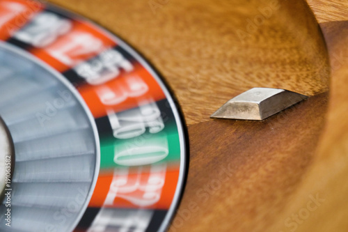 Macro shot of a roulette in a casino  People having bet and