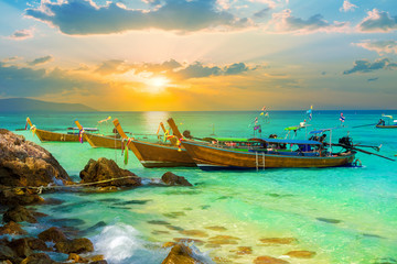 Beautiful colorful sunset over Bamboo island of Thailand. Summer holiday scene on tropical beach in Phi Phi region
