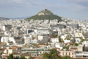 Panoramic view of mount Lycabettus and surrounding cityscape buildings from Athens Acropolis, Greece