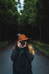 Woman with camera in woods