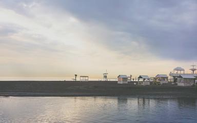 Spoed Foto op Canvas Stad aan het water Small coastal town at dawn. The urban coastal landscape.