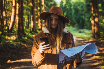 Woman with map in woods