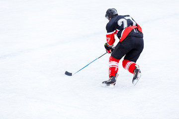 Ice hockey player with stick in attack. Ice hockey game