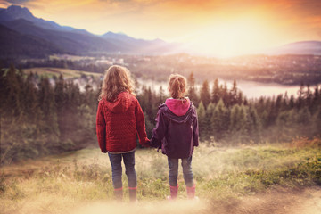 young friends look at the mountain land